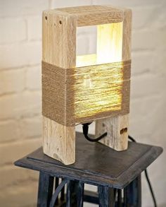 Cute Wood Table Lamp made with a Pallet Lovely wood lamp made with pallet parts and thin natural ropes.Fully handmade in Italy. Buy here The post Cute Wood Table Lamp made with a Pallet appeared first on Wood Diy. Table Lamp Wood, Wooden Lamp, Wooden Diy, Diy Table Lamps, Wooden Decor, Handmade Wooden, Into The Woods, Pallet Furniture, Furniture Design