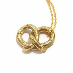 Will someone plz buy me this $170 pretzel necklace, because it looks like my tattoo? Thx