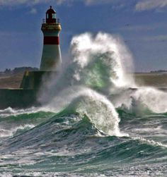 The North Sea crashing around the harbour lighthouse at Fraserburgh, which lies at the extreme northeast corner of Aberdeenshire, Scotland. Lighthouse Pictures, Stormy Sea, Beacon Of Light, Am Meer, Ocean Waves, Big Waves, Coastal, Beautiful Places, Waterfall