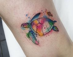 Watercolor turtle tattoo with small clown fish