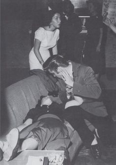 Elvis backstage tries to revive a female fan who swooned at the sight of him. The hysteria surrounding Elvis in the mid-50s was unbelievable.