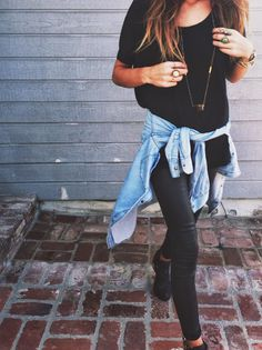 loose black top/skinny-fit pants/light washed denim shirt