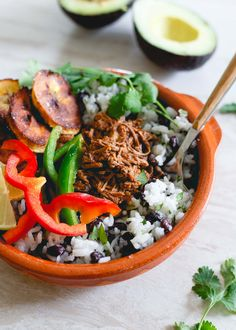 These shredded Mexican beef bowls are made in the slow cooker and perfect for weekly meal prep with rice, beans, plantains and peppers to round them out!