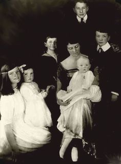 Katharine Hepburn's family portrait, early 1921. L to R: Katharine, Marion, Robert, Thomas, and Richard. Mrs, Hepburn is seated with daughter Margaret.