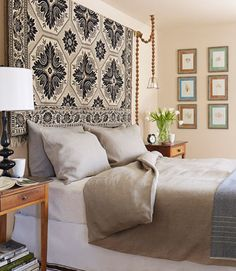 In the master bedroom, the owner of this historical Catskills home hung an 1854 textile in place of a headboard. The wall art is actually pressed sea kelp, purchased at a flea market during a vacation in Paris.