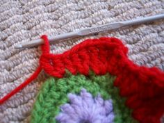 pinterest 365 day 242: learning to crochet ... so MUCH fun, thanks to the tutorial by rachel at maybe matilda and my sweet friend dee how showed me so many awesome stitches today!  then i used rachel's photo's and words to help me remember them tonight to finish my first flower ... totally proud :)