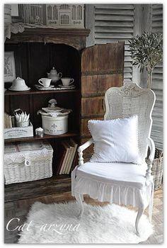 White chair, rug, pillow, and more ... Whttp://sphotos-a.ak.fbcdn.net/hphotos-ak-snc6/182689_553651514668482_1104232967_n.jpg