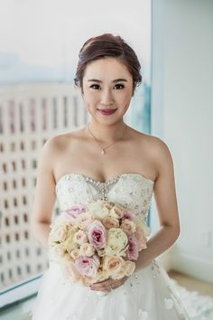 Elegant Bride with a Beaded Wedding Dress and a Pastel Bouquet | SIM Wedding Photography on @myhotelwedding via @aislesociety