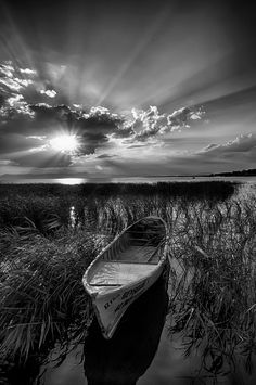 thephotographerssociety:  cemalsepici:    farewell song    I'm absolutely stunned by this one. The composition is simply sublime: see how it balances around the rising sun and the boat the fore.. But you can also being carried away by the fantastic b & w edition: delicate and expressive at the same time, in a way that strongly emphasizes shadows and contrasts, and protects the finer details of the image. -Juan Manuel