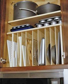 Shelves for storing cutting boards, trays, muffin pans, etc (above microwave)