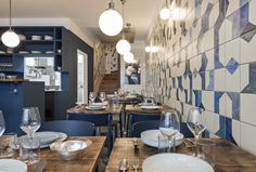 The hand-painted ceramic tile wraps along the wall and continues up the stairwell. Named after Belle Maison, after the owners' favorite beach, the restaurant is focused on seafood dishes.
