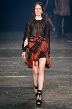 Black Accented with a deep Fall Orange Short Skirt by PatBo São Paulo Fall 2016 Collection Photos - Vogue