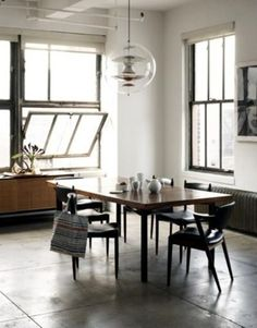 Love the  floor and windows... Ver industrial looking and yet cosy!