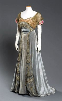 "Silk evening Dress, Fox, 1909. ""With its interplay of reflective materials, this romantic evening dress characterizes the close of La Belle Époque, the ""beautiful era"" during which the arts flourished in Paris. The owner of the dress was a woman of cultivated taste, most likely Jane Taft Ingalls, the niece of President William Howard Taft."""