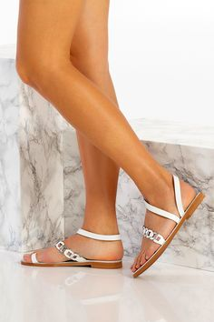 Classic with a twist, Eve sandals featuring our signature chain strap with a plain toe ring and ankle wrap. Handmade of the best quality leather, these unique flat shoes for women are the type you can wear instead of heels without feeling under-dressed. Classy yet comfy and so lightweight that they feel as if you're wearing virtually nothing at all. A great choice for elegant, modern and boho bride. Greek Chic Handmades sandals are designed and handcrafted in Athens, Greece. Find your favs! Toe Ring Sandals, Bridal Sandals, Ankle Wrap Sandals, Toe Rings, Leather Sandals, Ankle Strap, Flat Sandals, Strap Sandals, White Wedding Shoes