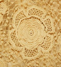 close- up of flower/roses shaped lace detail.