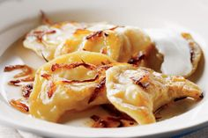 The traditional (and indulgent) toppings of crispy crumbled bacon and sour cream really bring these perogies to life.