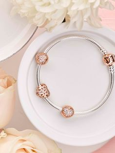 This season, the PANDORA Rose collection presents glittering and timeless jewellery designs adorned with iconic motifs of love, nature and unbreakable bonds, resplendent in blush-hued metal. #PANDORArose #PANDORAbracelet