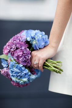 I love hydrangias (spelling?) for wedding flowers. They're so colorful and large. Perfect for center pieces, boquets, and more.