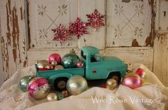 vintage turquoise toy truck and glass christmas ornaments