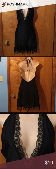 Black party dress Size small. Embellished bottom and lacy top. Dresses Backless