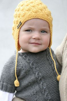 knit wear is great for kids, especially the very young ones. We love the look this cap brings, and the strings that dangle from it.