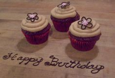 Chocolate Cupcakes with Mocha Frosting.  Chocolate flowers with fondant centres.