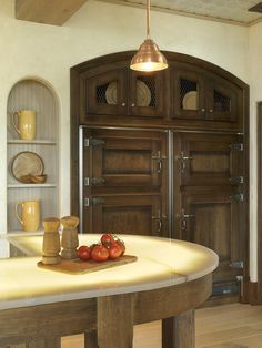 Built-in, custom refrigerator crafted in the image of an old-time icebox