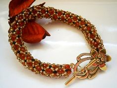 RED AND GOLD CRYSTAL BEADED BRACELET £12.00 http://folksy.com/items/4881462-RED-AND-GOLD-CRYSTAL-BEADED-BRACELET