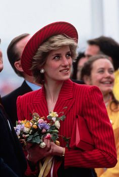 Princess Diana visits Vancouver during her Royal Tour of Canada May 15, 1986 in, wearing a red and navy striped suit by designer Catherine Walker and a Breton style hat by Graham Smith at Kangol.