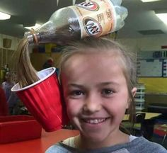 This girl went to school on crazy hair day with this insane updo: Her hair looks like root beer being poured into a cup!