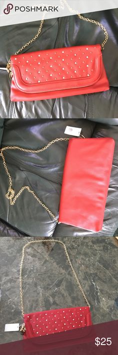 Dark Red Purse with gold chain New red purse with gold zippers, gold chain and gold accents along with silver rhinestones. The bag has one giant pocket and one smaller area. Can be used as a cross body bag or shoulder. Bags Crossbody Bags