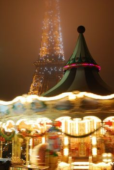 The magical energy of Paris at night is highlighted thanks to a spinning carousel.