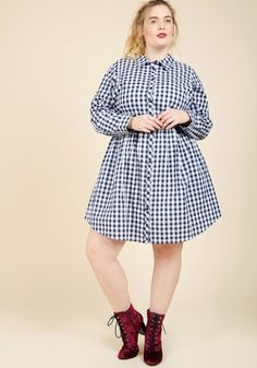 Sample in Style Shirt Dress | Mod Retro Vintage Dresses | ModCloth.com  Whether it's aged wine, IPAs, or appetizers you're savoring, this gingham dress will guarantee you do it in good taste! Part of our ModCloth namesake label, this cotton button up has detectable notes of timelessness with its white-and-navy color scheme, tab sleeves, and hidden pockets.