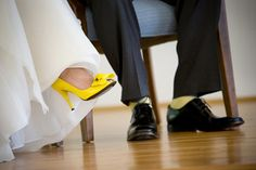 still trying to convince the groom!! lmao ...yellow shoes on the bride and yellow socks on the groom ;)