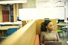 Young woman in casual office with laptop
