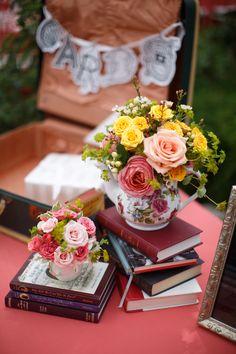 Books and tea pots. Flowers and Decor: La Petite Fleur Weddings and Events. Photography: Gene Smirnov - smirnovweddings.com/