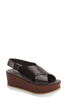 Free shipping and returns on Kenneth Cole New York 'Mila' Sandal (Women) at Nordstrom.com. A textured, wood-like platform adds to the retro-chic appeal of a chic, Italian crafted sandal fashioned with ultrasmooth leather straps.