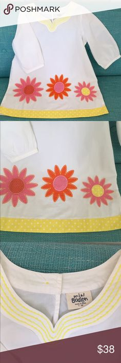 HP🎉🎉NWOT Mini Boden tunic Bright beautiful girls Mini Boden tunic. Multi colored flowers embroidered on the front. Yellow dotted trim along hem. Sz 7-8. NWOT. Ordered online from Mini Boden and my daughter never wore it! So pretty, whimsical and fun! 🌻🌸🌷🌼💕😊☀️ Mini Boden Shirts & Tops