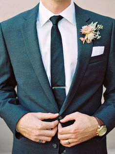 Stylish, modern groom in a close-cut suit. Unique boutonniere inspired by desert flowers. - Melissa Jill Photography