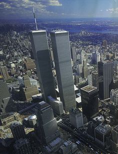 aerial view of the twin towers of world trade center looking northeast showing new 40 story dow jones building september 1985