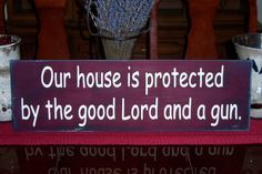 Our House Is Protected By The Good Lord And A Gun Distressed Hand Painted Wood Sign. $30.00, via Etsy.