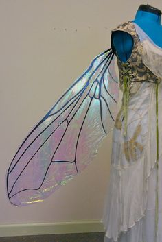 These are large fly fairy wings made with a very lightweight cut aluminum sheet and a laminated iridescent film that reflects a rainbow of colors.