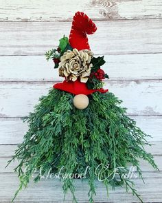 Gnome with faux filler and wood flowers. This would be so adorable sitting on a table, under the tree or on the front porch. Sola Wood Flowers, Christmas Wreaths, Christmas Ornaments, Gnomes, Front Porch, A Table, Holiday Decor, Home Decor, Decoration Home