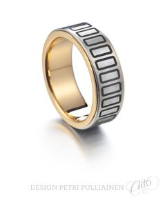 Laser engraved stainless steel ring with 750‰ yellow gold. Photo Teemu Töyrylä.