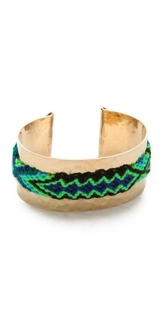 Mercedes Salazar Hammered Friendship Cuff +  FREE SHIPPING at shopbop.com. A woven friendship bracelet brings cheerful color to a hammered cuff from Mercedes Salazar.