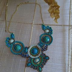 Nwt Boho statement necklace New never worn. Gorgeous blues, teal and muted gold sequins. Felt backing. Great with a maxi. Target Jewelry Necklaces