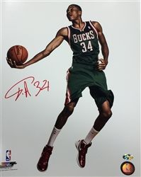 bc78ee169 Milwaukee Bucks star Giannis Antetokounmpo autographed photo He signed the  photo in permanent red ink.