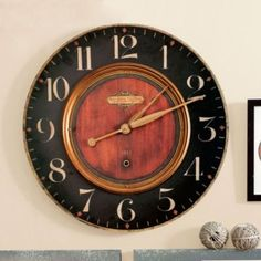 Alexander Martinot Clock. Ballard Designs. Great look for the box office -- dramatic, but easy to read.