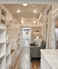 This is the gorgeous Kate by Tiny House Building Company. The inside of this tiny house on wheels is absolutely stunning. The home features two queen-sized lofts accessible by a split staircase. Tiny House Layout, Tiny House Cabin, Tiny House Plans, Tiny House On Wheels, Tiny House Design, House Layouts, Casa Loft, Sweet Home, Casas Containers